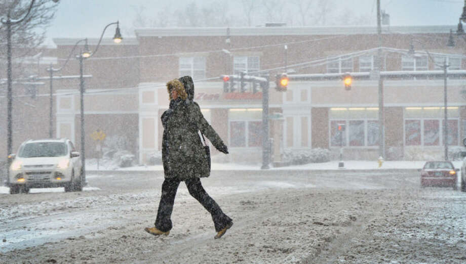 Hour Photo/Alex von Kleydorff Snow falls at an inch an hour Monday morning as people make their along Belden Ave in Norwalk.