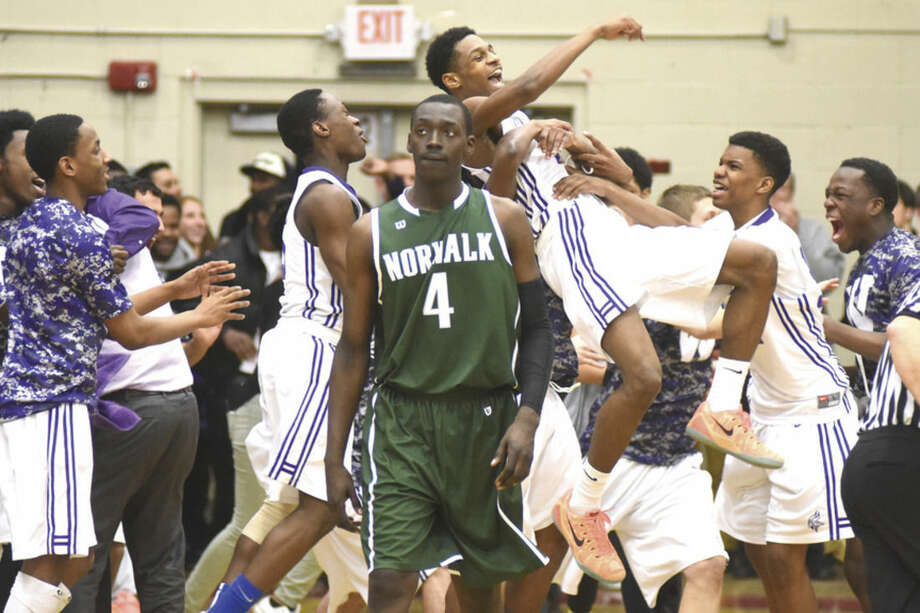 Hour photo/John Nash - Norwalk made it to the FCIAC boys basketball champiionship game, only to fall to Westhill.