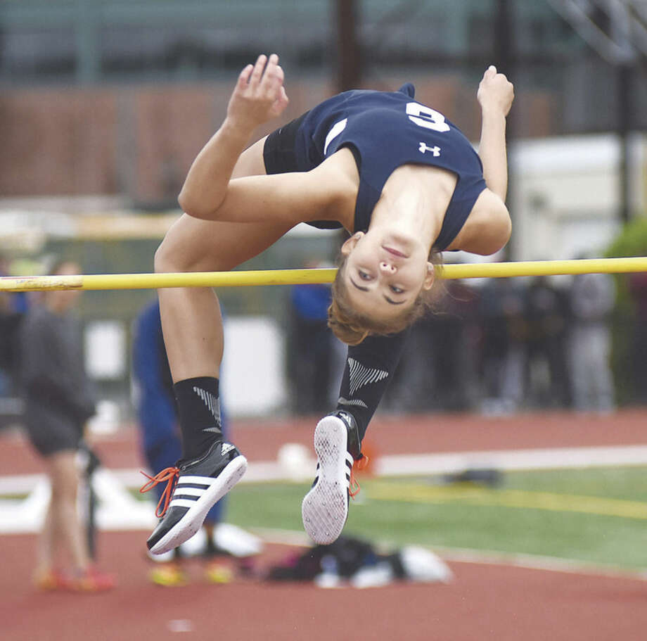 Hour photo/John Nash - Elizabeth Knoll of Staples helped her girls track team win an FCIAC championship in 2015.