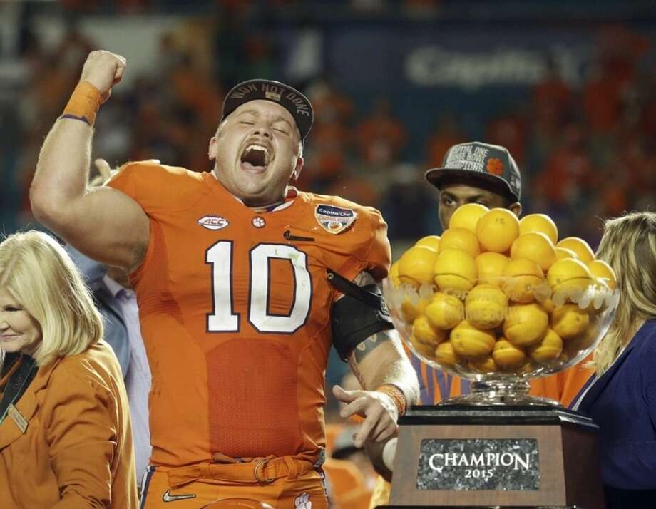 Clemson linebacker Ben Boulware (10) cheers during the award presentation after his team won the Orange Bowl NCAA college football semifinal playoff game against Oklahoma, Thursday, Dec. 31, 2015, in Miami Gardens, Fla. Clemson defeated Oklahoma 37-17. (AP Photo/Lynne Sladky)
