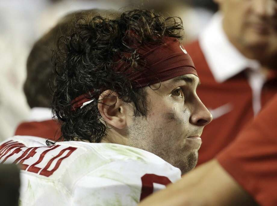Oklahoma quarterback Baker Mayfield (6) looks up from the sidelines during the second half of the Orange Bowl NCAA college football semifinal playoff game against Clemson, Thursday, Dec. 31, 2015, in Miami Gardens, Fla. Clemson defeated Oklahoma 37-17 to advance to the championship game. (AP Photo/Lynne Sladky)