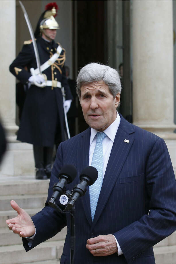US Secretary of State John Kerry delivers a statement at the Elysee Palace after his meeting with French President Francois Hollande in Paris, France, Tuesday, Nov. 17, 2015. The civilized world must boost its efforts to combat the Islamic State by going after the group at its core, US. Secretary of State John Kerry said Tuesday as he met in Paris with French President Francois Hollande to show solidarity with France in the wake of last week's attacks. (AP Photo/Francois Mori)