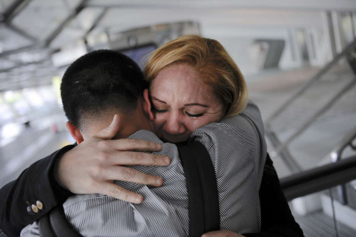 ADVANCE FOR USE SATURDAY, FEB. 8, 2014 AND THEREAFTER - In this Wednesday, Dec. 25, 2013 photo, Melba Soza embraces her son Jose Antonio as he arrives at the Bilbao airport in Bilbao, Spain from the United States for a five-day visit. For the past three years, Jose has been on a mission: To bring his mother back to the U.S. His work has taken him to Congress, gotten him meetings with the likes of Donald Trump and Mark Zuckerberg, landed him on television. Along the way, he has grown into a steady force in the national immigration debate, a young but powerful voice for his family and the many others hoping to one day reunite. (AP Photo/Alvaro Barrientos)