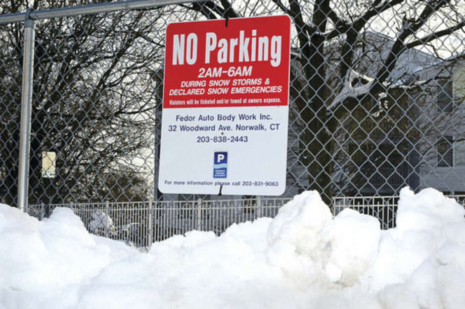 Hour photo / Erik Trautmann The Norwalk Parking Authority reportedly had 37 vehicles towed in South Norwalk, including at train station, during Monday snowstorm.