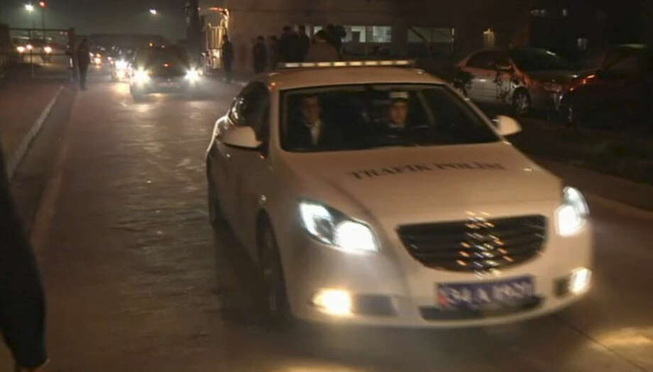"In this image from TV, a police vehicle carrying Huseyin Avni Mutlu, the Istanbul governor, leads a convoy of cars believed to be carrying released passengers who were held hostage aboard a plane, Friday Feb. 7, 2014. All 110 passengers aboard the plane were evacuated ""without any problems"" after authorities subdued a man who attempted to hijack a Turkish plane to Sochi, Russia. (AP Photo / APTN) TV OUT"