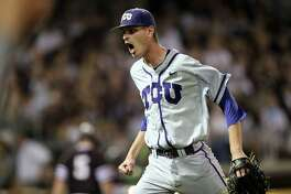 TCU's Brian Howard (44) celebrates after striking out the last Texas A&M batter of the sixth inning of a NCAA college baseball Super Regional tournament game, Sunday, June 12, 2016, in College Station, Texas. (AP Photo/Sam Craft)