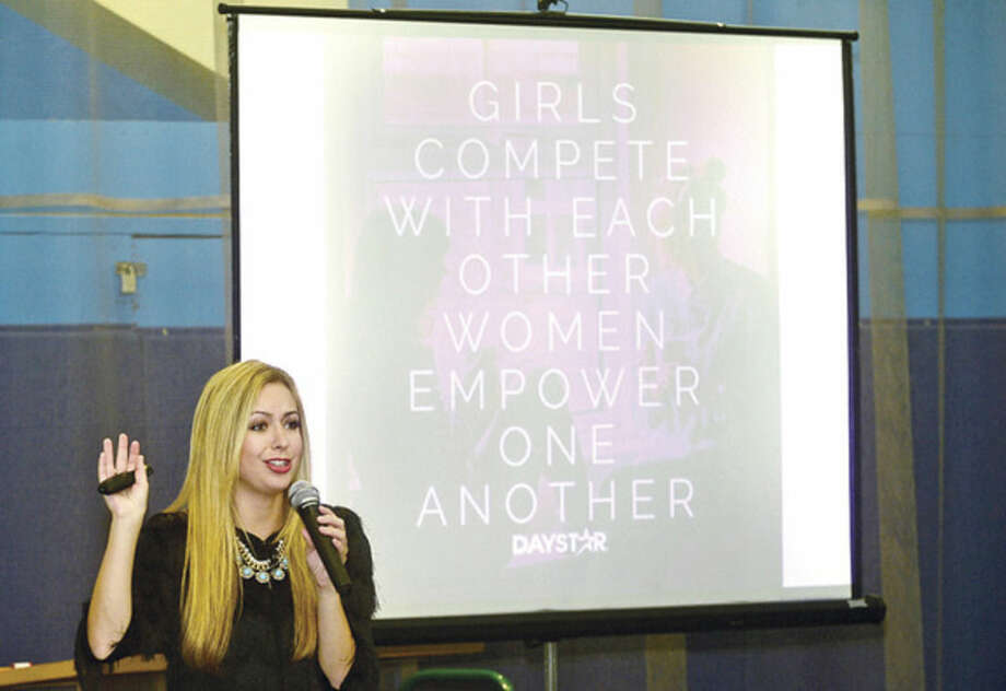 Hour photo / Erik Trautmann Lauren Galley, president of Girls Above Society gives the keynote address during The Fund for Women and Girls 3rd annual Girls Leadership Summit Friday at Chelsea Piers in Stamford.