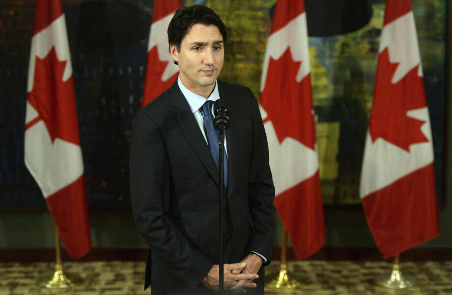 Canadian Prime Minister Justin Trudeau addresses the media on the terrorist attacks in Paris prior to his departure for the G20 and APEC summits from Ottawa, Friday, Nov. 13, 2015. Trudeau says Canada has offered all the support it can to France following Friday's attacks in Paris. (Sean Kilpatrick/The Canadian Press via AP)