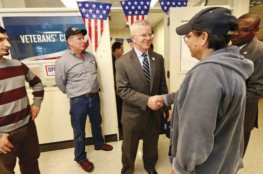 Hour photo / Erik Trautmann Veterans at Norwalk Community College's Veteran's Club including Rocco D'Amato, Tom Dorney and Tina Kovacs are greeted by Connecticut Veterans Affairs Commissioner Sean Connolly during a visit at the college Thursday,