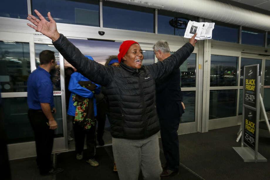 Dollie Merritt reacts after entering Best Buy as it opens on Thanksgiving, Thursday, Nov. 26, 2015, in Minnetonka, Minn. (AP Photo/Bruce Kluckhohn)