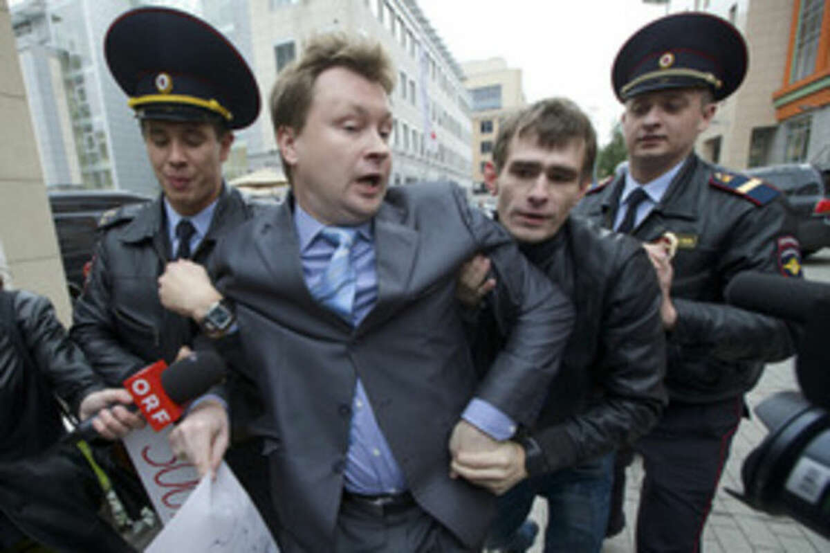 AP file photo / Ivan Sekretarev In this Wednesday, Sept. 25, 2013 file photo, police detain Russia's leading gay rights campaigner Nikolai Alexeyev, center, during a protest outside the Sochi 2014 Winter Olympic Games organizing committee office, in downtown Moscow.