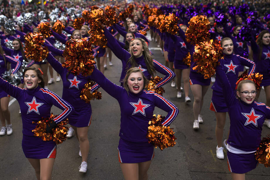 Cheerleaders march across Sixth Avenue during the Macy's Thanksgiving Day Parade, in New York, Thursday, Nov. 26, 2015. (AP Photo/Andres Kudacki)