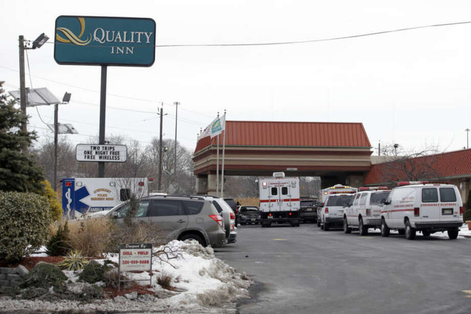 Emergency vehicles gather at the Quality Inn near the site of NFL Super Bowl XLVIII, Friday, Jan. 31, 2014, in Lyndhurst, N.J. (AP Photo/Matt Slocum)