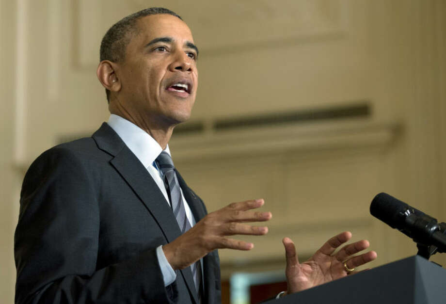 President Barack Obama gestures as he speaks in the East Room of the White House, Friday, Jan. 31, 2014, in Washington, about helping the long-term unemployed. (AP Photo/Carolyn Kaster)