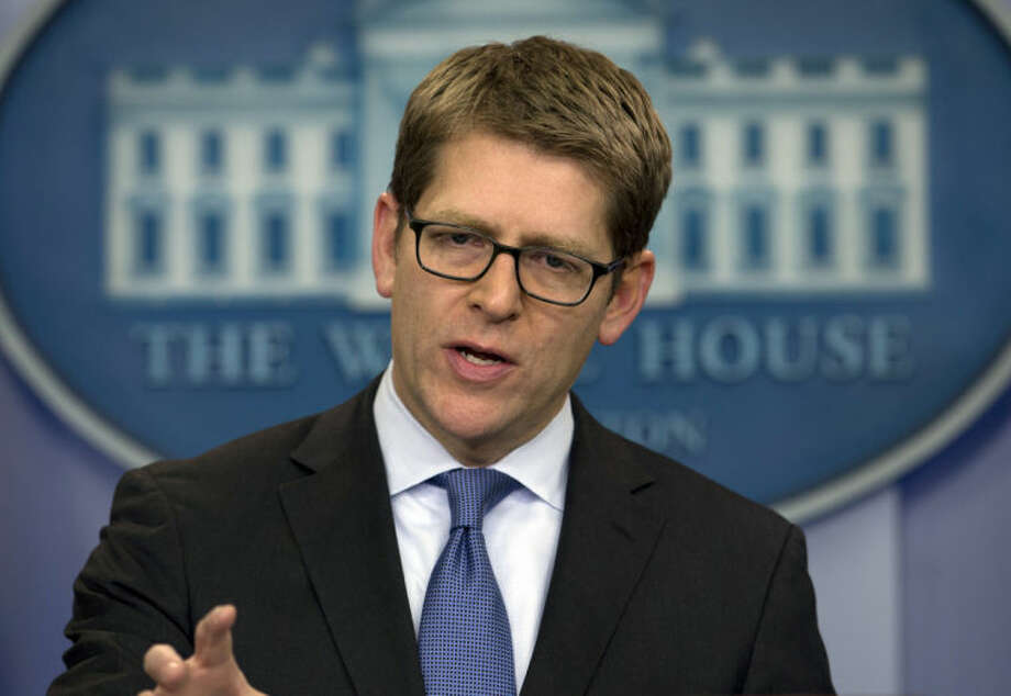 White House press secretary Jay Carney speaks during the daily news briefing at the White House, Friday, Jan. 31, 2014, in Washington. Carney discussed immigration reform, Syria, and other topics. (AP Photo/Carolyn Kaster)