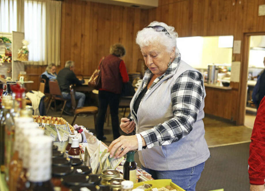 Flo Stolba shops for gifts during the American Legion Holiday Fair on County Street in Norwalk Sunday afternoon.Hour Photo / Danielle Calloway
