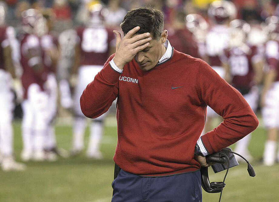 Connecticut head coach Bob Diaco looks down as he rubs his head during the second half of an NCAA college football game against the Temple, Saturday, Nov. 28, 2015, in Philadelphia. Temple won 27-3. (AP Photo/Chris Szagola)