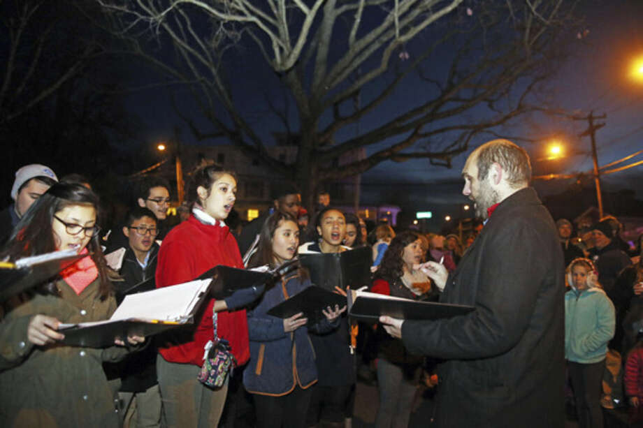 The BMHS Carolers sing for guests at the Light Up Rowayton event Sunday evening.Hour Photo / Danielle Calloway