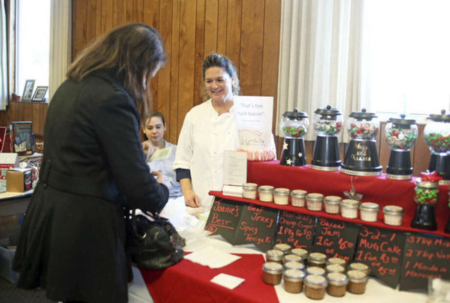 Joan Evon from Joanie's Jerky and Jam sells some jam to a customer during the American Legion Holiday Fair on County Street in Norwalk Sunday afternoon.Hour Photo / Danielle Calloway