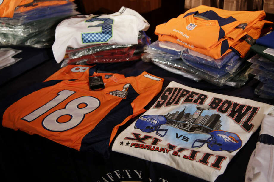 Seized counterfeit NFL merchandise is displayed before a news conference at the NFL Super Bowl XLVIII media center, Thursday, Jan. 30, 2014, in New York. (AP Photo)