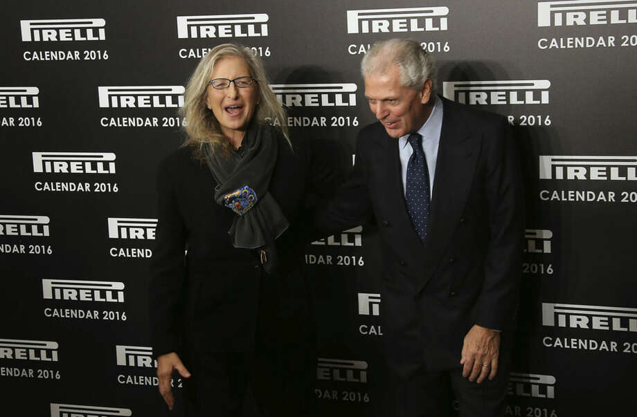 Photographer Annie Leibovitz and chairman and chief executive officer of Pirelli, Marco Tronchetti, pose for photographers upon arrival for the Pirelli Calendar 2016 launch at the Grosvenor Hotel Ballroom in London, Monday, Nov. 30, 2015. (Photo by Joel Ryan/Invision/AP)