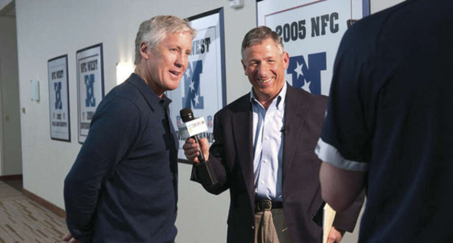 Photo courtesy of Seahawks.comFormer Wilton resident Tony Ventrella, right, interviews Seattle Seahawks head coach Pete Carroll inside the NFL team's training facility in Seattle earlier this season. Ventrella has returned 'home' to the tri-state area to help cover the Seahawks' Super Bowl run.