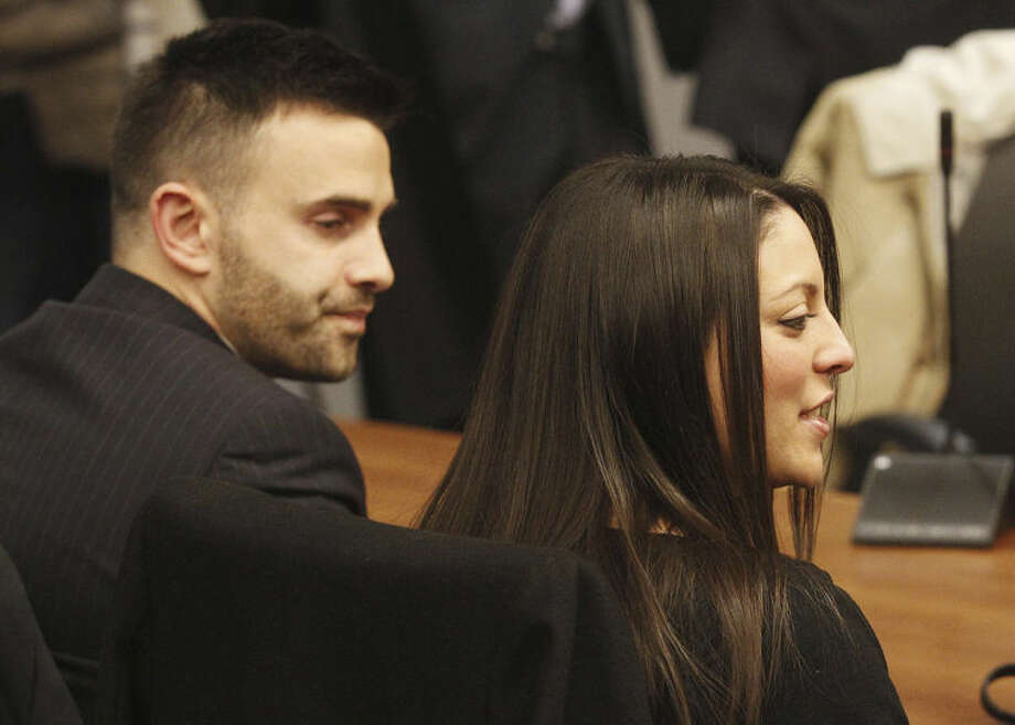 Meredith Kercher's brother Lyle, left, and sister Stephanie wait for the reading of the verdict for the murder of the British student in Florence, Italy, Thursday, Jan. 30, 2014. An appeals court in Florence upheld the convictions of U.S. student Amanda Knox and her ex-boyfriend for the 2007 murder of her British roommate. Knox was sentenced to 28 1/2 years in prison, raising the specter of a long legal battle over her extradition. After nearly 12 hours of deliberation Thursday the court reinstated the guilty verdict first handed down against Knox and Raffaele Sollecito in 2009. (AP Photo/Fabrizio Giovannozzi)