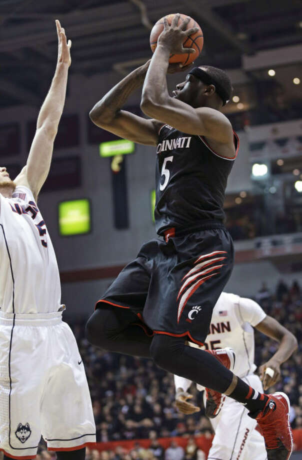 Cincinnati forward Justin Jackson (5) shoots against Connecticut during the first half of an NCAA college basketball game, Thursday, Feb. 6, 2014, in Cincinnati. (AP Photo/Al Behrman)