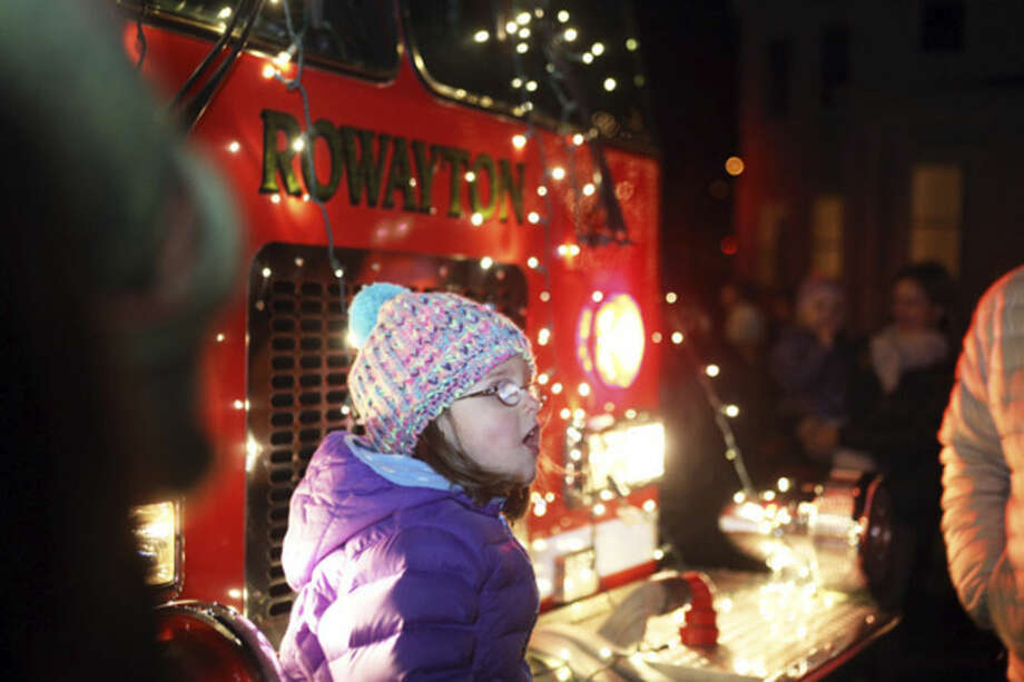 Catherine Binkley, 4, calls for Santa at the Light Up Rowayton event Sunday evening.Hour Photo / Danielle Calloway