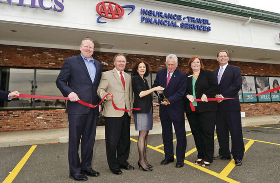 Hour photo / Erik TrautmannBrian Griffin, vice president of the Greater Norwalk Chamber of Commerce, Lloyd P. Albert, Senior Vice President, Public / Government Affairs & New Business Development at AAA Northeast, State Representative Gail Lavielle, Norwalk Mayor Harry Rilling, AA Branch Manager Christine Lucsky, Brendan Coughlin, AAA Director, Regional Brach Sales and Service, cut the ribbon for the new AAA branch on Westport Ave.