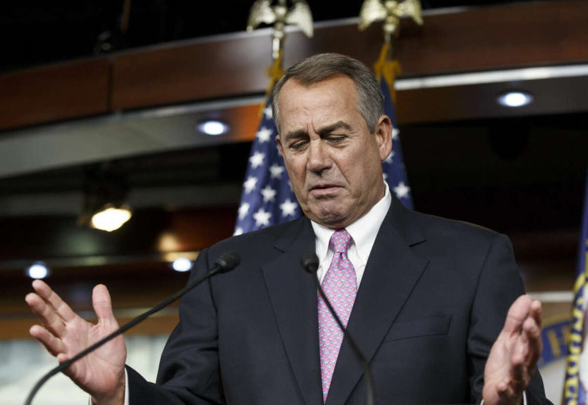 FILE - In this Feb. 6, 2014, photo, House Speaker John Boehner of Ohio gestures while speaking during a news conference on Capitol Hill in Washington. The road the country has been on for the past five years is now beginning to come to an end. The Federal Reserve, which pumped $3 trillion into the economy to keep the Great Recession from worsening, is withdrawing its financial lifeline amid signs of fresh economic growth. The nation?'s gross domestic product is inching up and annual federal budget deficits are heading down. How Washington policymakers respond to the improvements in the economy may even sow the seeds for more cooperation in Washington.