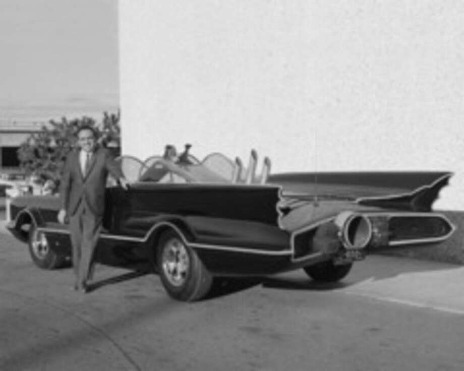 This 1966 photo provided by Lozzi Media Services and Barris Kustom Industries shows designer George Barris with the original Batmobile in Los Angeles. Barris, who created television's original Batmobile, along with scores of other beautifully customized, instantly recognizable vehicles that helped define California car culture, has died at age 89. Barris Kustom Industries spokesman Edward Lozzi says Barris died Thursday, following a lengthy illness. (Lozzi Media Services/Barris Kustom Industries via AP)