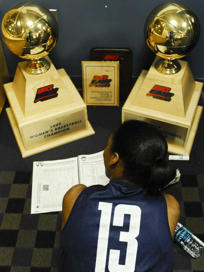 Connecticut's Brianna Banks reads over a media guide in the UConn locker room before practice for a first-round game in the NCAA women's college basketball tournament, Saturday, March 22, 2014, in Storrs, Conn. Connecticut practices in advance of Sunday's NCAA first round women's tournament basketball game against Prairie View A&M. (AP Photo/Jessica Hill)
