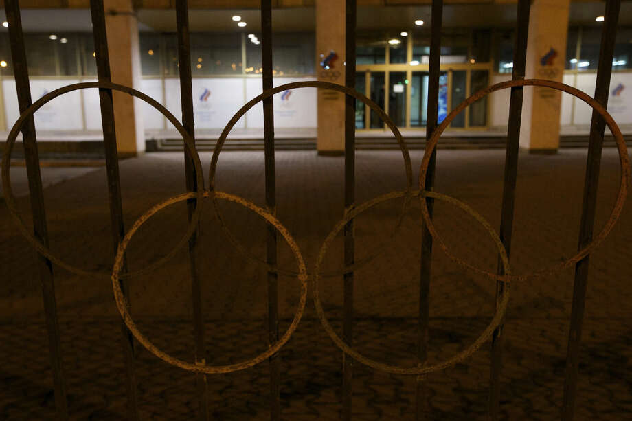 Rusty Olympic rings decorate a fence outside the Russian Olympic committee building in Moscow, Russia, Monday, Nov. 9, 2015. Russian track and field athletes could be banned from next year's Olympics in Rio de Janeiro after a devastatingly critical report accused the country's government of complicity in widespread doping and cover-ups. (AP Photo/Ivan Sekretarev)