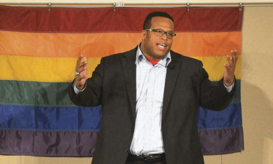 Hour Photo/Alex von Kleydorff. Keynote speaker Akil Patterson, Youth Program director at Athlete Ally speaks during UCONN Stamford's Coming out to Open Arms