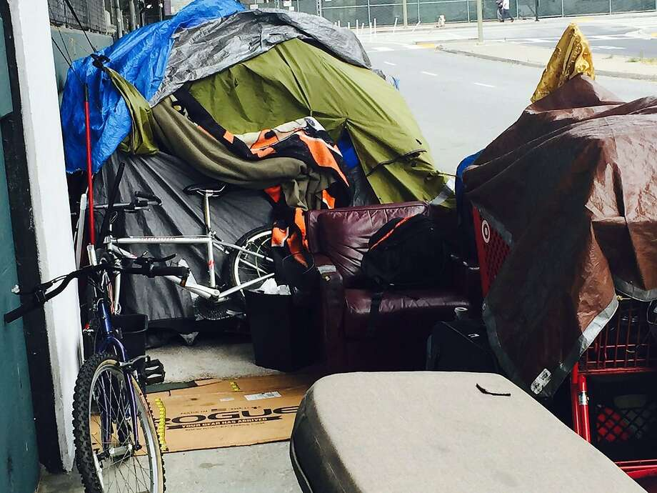 This homeless encampment on Essex Street has a tent, bike and leather armchair Photo: C.W. Nevius