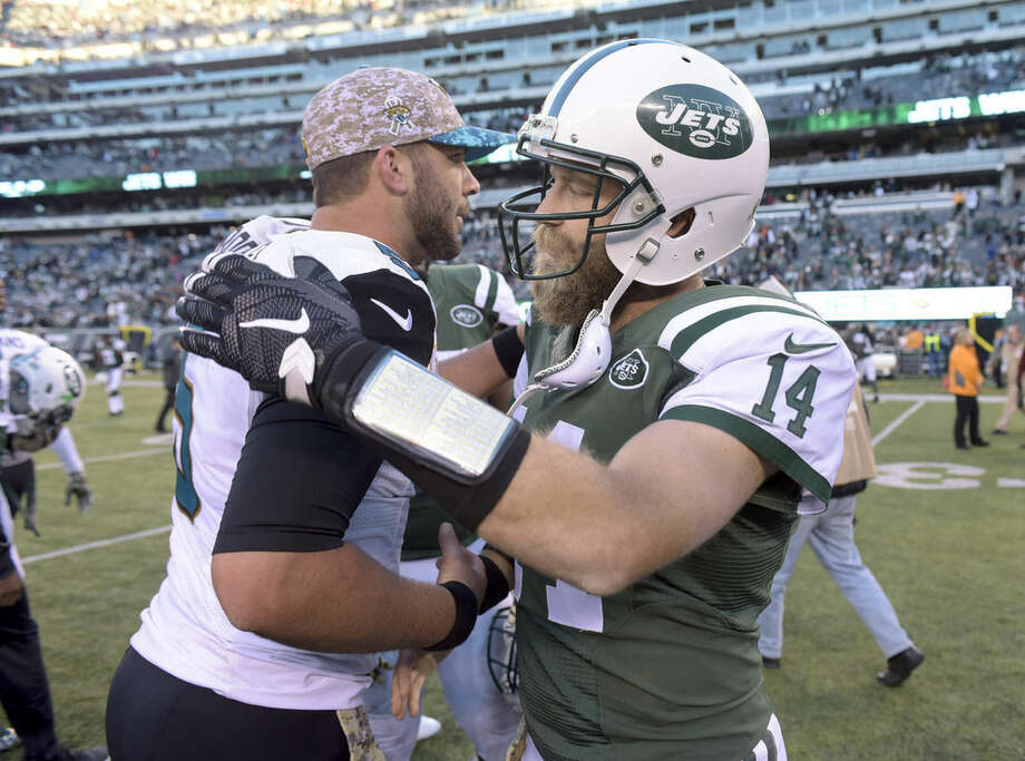 New York Jets quarterback Ryan Fitzpatrick (14) greets Jacksonville Jaguars quarterback Blake Bortles (5) after the Jets beat the Jaguars 28-23 in an NFL football game, Sunday, Nov. 8, 2015, in East Rutherford, N.J. (AP Photo/Bill Kostroun)