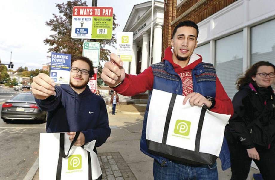 Hour photo/Erik TrautmannNorwalk Community College (NCC) students in Professor Susan Steiz's marketing class are getting a lesson in how to market a product in the real world, helping the Norwalk Parking Authority get the word out about its Parkmobile app.
