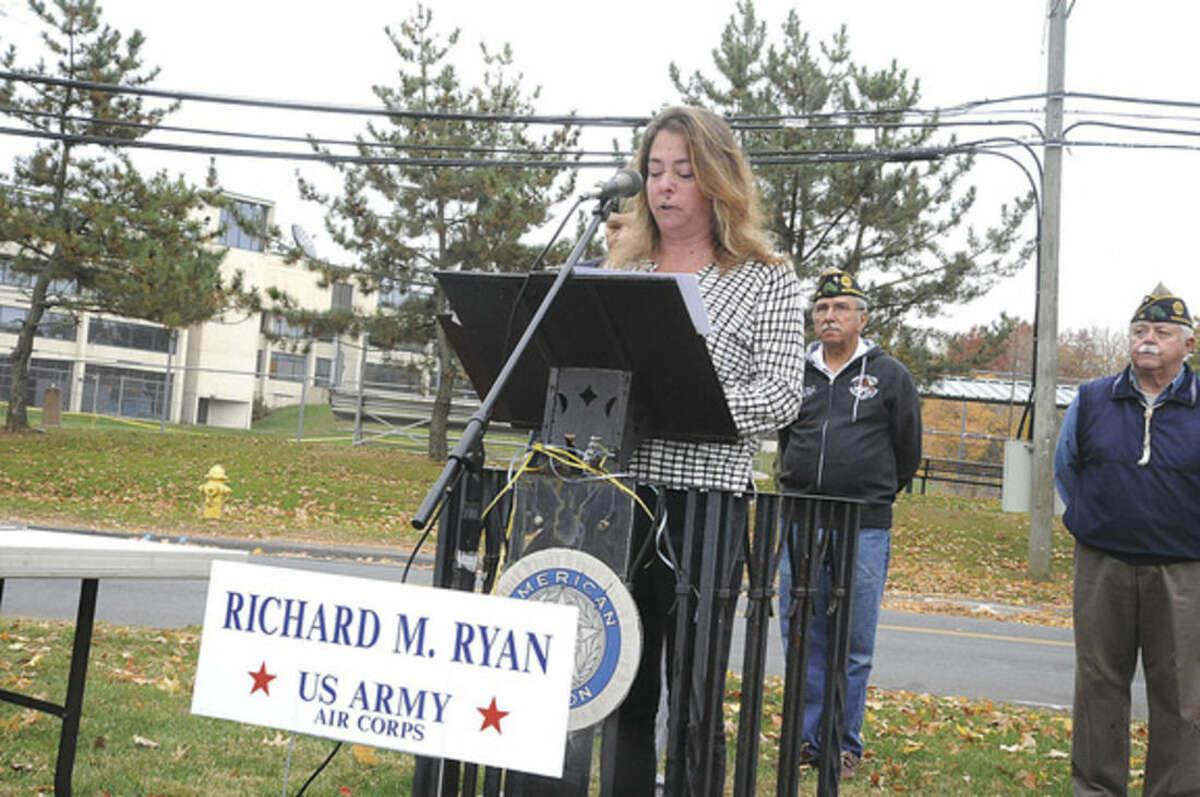 Hour photo/Matthew Vinci Jennifer Ryan, grandaughter of Veteran of the Month U. S. Army Air Corps Richard M. Ryan speaks at the monthly ceremony at American Post 12 in Norwalk.