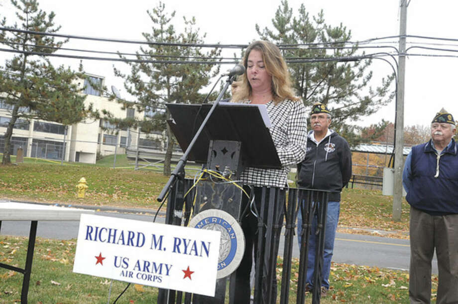 Hour photo/Matthew VinciJennifer Ryan, grandaughter of Veteran of the Month U. S. Army Air Corps Richard M. Ryan speaks at the monthly ceremony at American Post 12 in Norwalk.