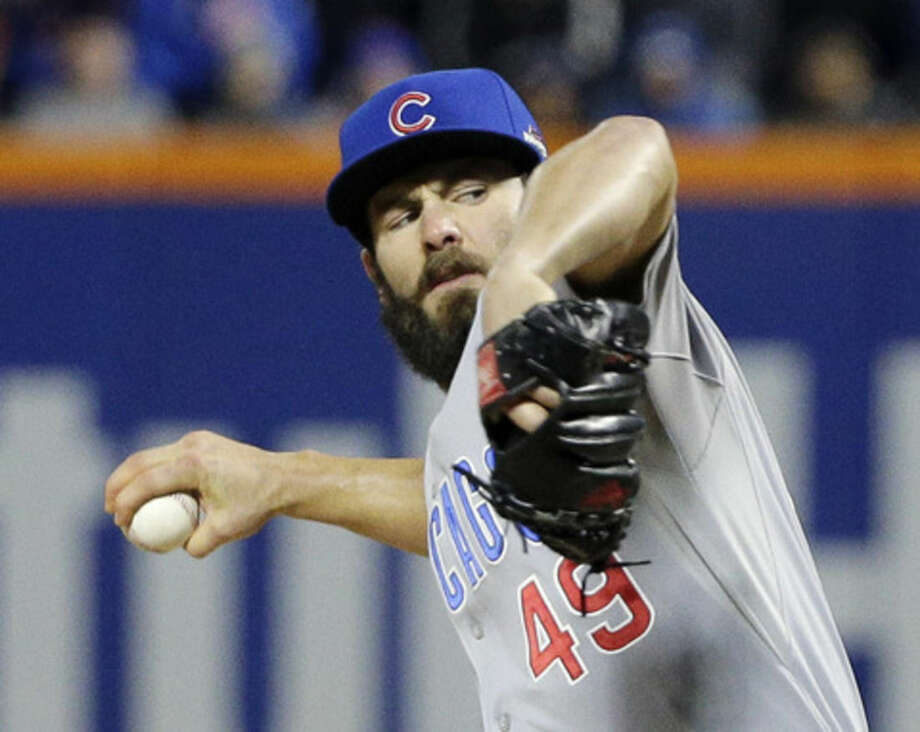 Chicago Cubs pitcher Jake Arrieta throws during the first inning of Game 2 of the National League baseball championship series against the New York Mets Sunday, Oct. 18, 2015, in New York. (AP Photo/Julie Jacobson)