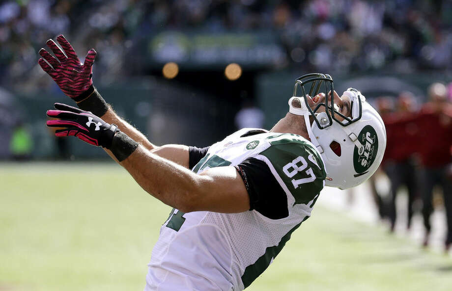 New York Jets wide receiver Eric Decker reacts after being tackled short of the end zone on a catch against the Washington Redskins during the first half of an NFL football game, Sunday, Oct. 18, 2015, in East Rutherford, N.J. (AP Photo/Seth Wenig)