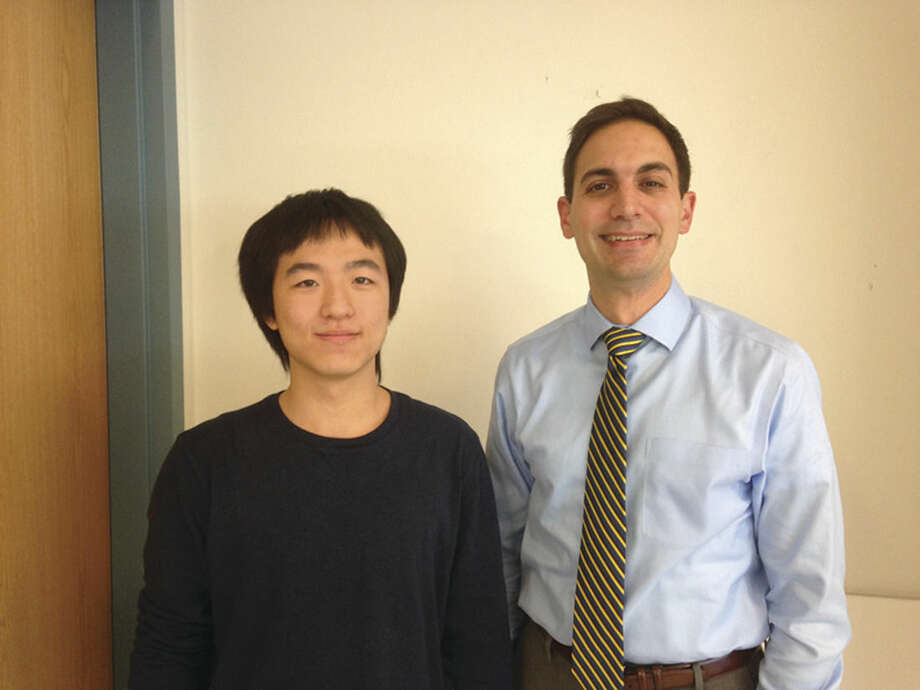 Contributed photoScholarship winner Jim Zhang, left, and Nick Morgan, right.
