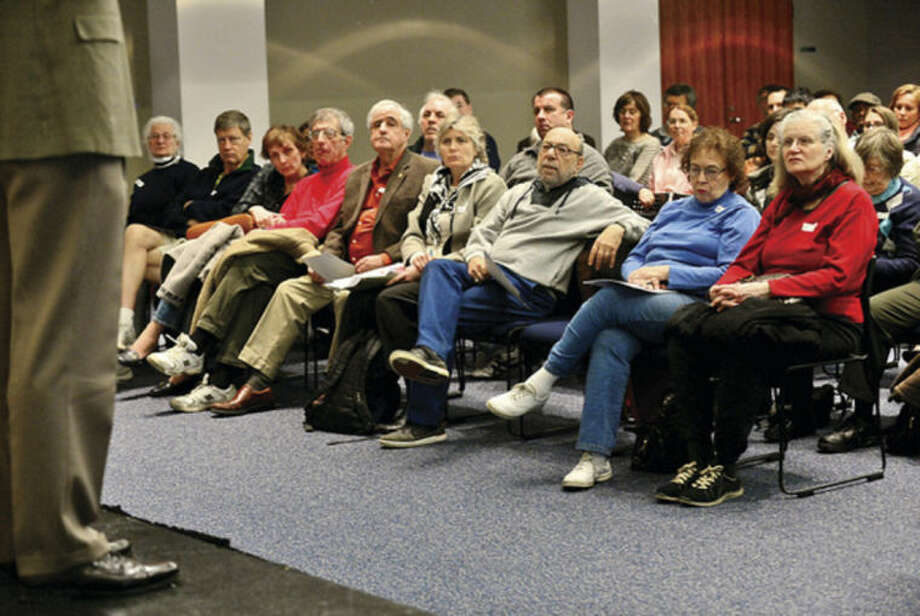 Hour photo / Erik Trautmann Constituents listen to US Congressman Jim Himes during a town hall style meeting at UCONN Stamford Campus Saturday afternoon.