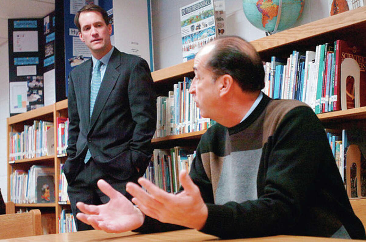 Principal Tony Ditrio talks with Congressman Jim Himes while the lawmaker visited Kendall Elementary School in Norwalk Tuesday to tour the classrooms and discuss ways to improve federal intiatives like Head Sart and No Child Left Behind. Hour photo / Erik Trautmann