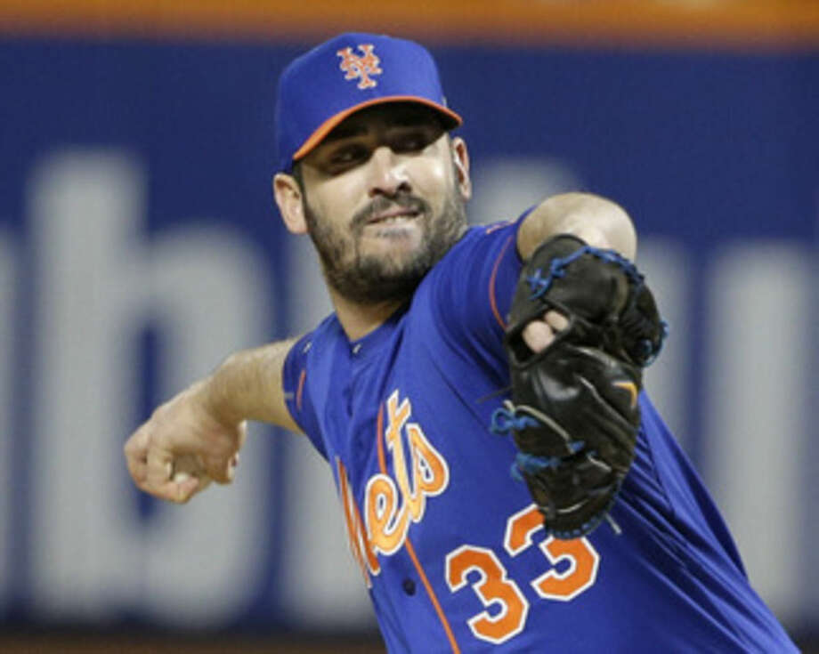 New York Mets pitcher Matt Harvey throws during the first inning of Game 1 of the National League baseball championship series against the Chicago Cubs Saturday, Oct. 17, 2015, in New York. (AP Photo/Julie Jacobson)