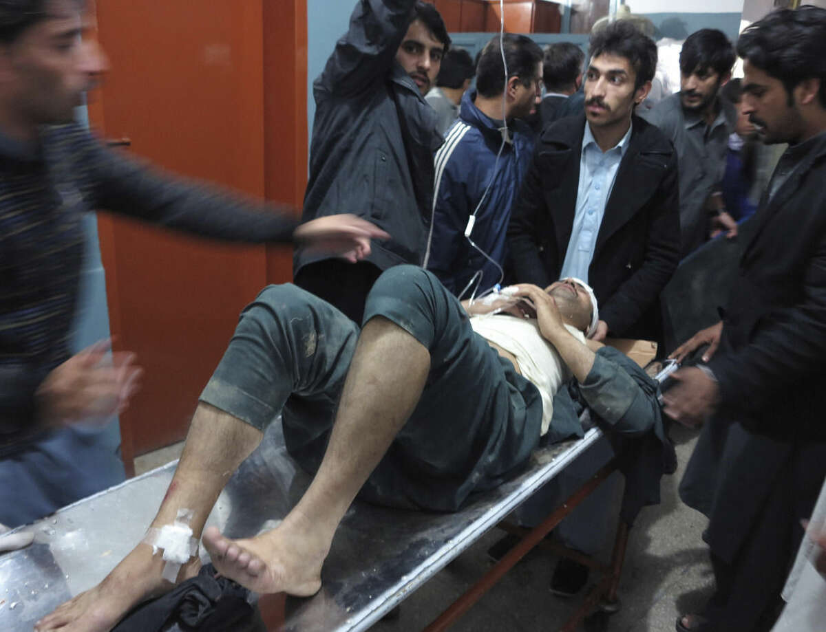 A patient is brought to a hospital after severe earthquake was felt in Mingora, the main town of Pakistan Swat valley, Monday, Oct. 26, 2015. A powerful 7.7-magnitude earthquake in northern Afghanistan rocked cities across South Asia. Strong tremors were felt in Kabul, New Delhi and Islamabad on Monday. In the Pakistani capital, walls swayed back and forth and people poured out of office buildings in a panic, reciting verses from the Quran. (AP Photo/Naveed Ali)