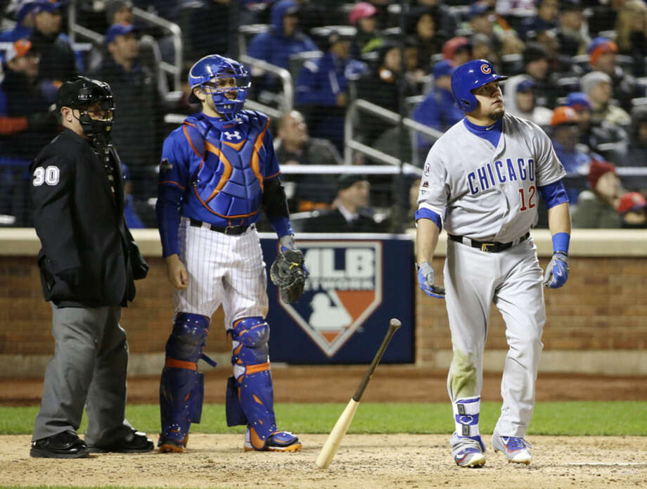 Chicago Cubs' Kyle Schwarber watches his home run during the eighth inning of Game 1 of the National League baseball championship series against the New York Mets Saturday, Oct. 17, 2015, in New York. (AP Photo/David J. Phillip)