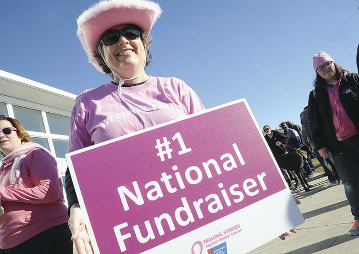 Hour photo/Matthew Vinci Seven-year breast cancer survivor Neva Weber attends the annual Making Strides Against Breast cancer walk & fundraiser at Sherwood Island Park in Westport on Sunday.