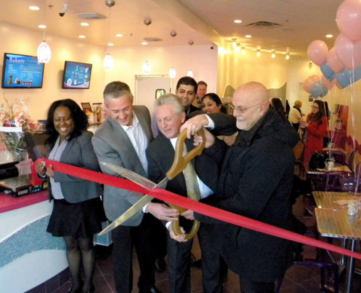 Contributed photo The ceremonial ribbon cutting at Frulala, a frozen yogurt eatery on Main Avenue in Norwalk.